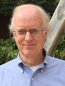 Headshot of M.R..RC. Director John Laitner